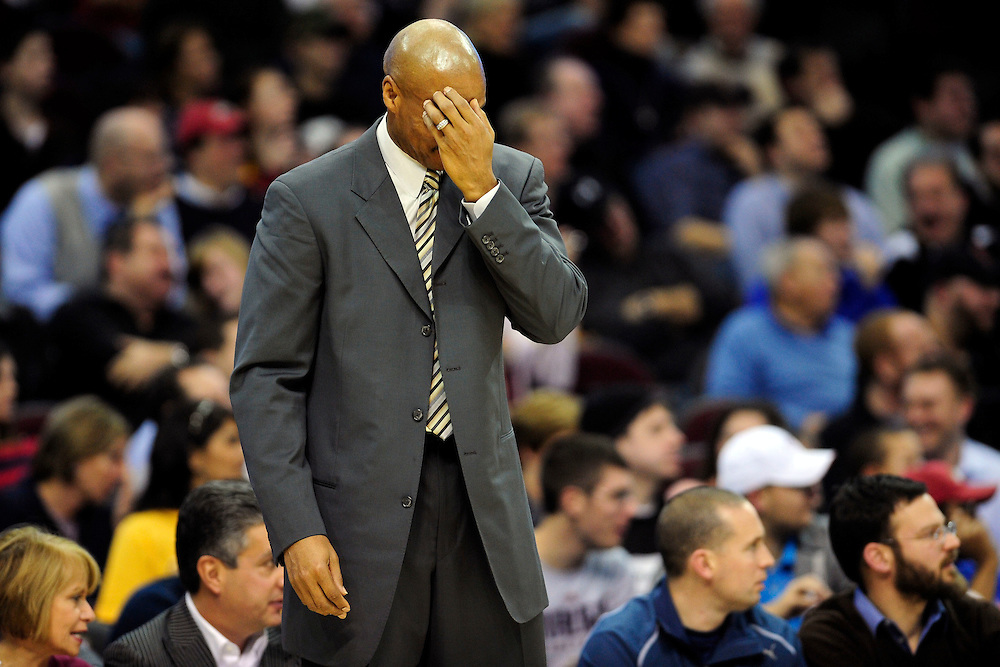 Jan. 19, 2011; Cleveland, OH, USA; Cleveland Cavaliers head coach Byron Scott hides his face after Cleveland Cavaliers small forward Jamario Moon (15)(not shown) nearly knocked in a point for Phoenix Suns during the fourth quarter at Quicken Loans Arena. The Suns beat the Cavaliers 106-98. Mandatory Credit: Jason Miller-US PRESSWIRE