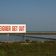 "Signs reading ""foreigner get out"" at the TPI Ban Laem site in Phetchaburi, Thailand. The signs are part of a local opposition campaign to the foreign ownership and managing of local oil company, TPI."
