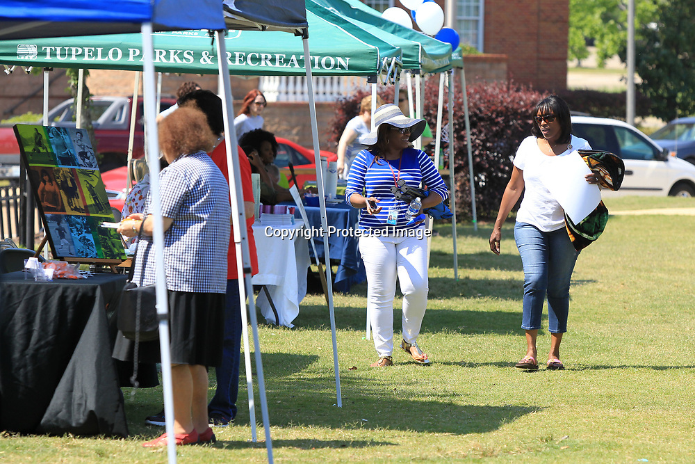 Melody Laury and Tameka Shinault with the Mississippi Department of Rehabiliation Services, walk to their booth at the LIFE and Our Artworks cookout and Resource Fair on Tuesday in Fairpark in Tupelo. The Mississippi Department of Rehabiliation Services, provides apporiate and comprehensive services to Mississippians with disabilities and to help them gain and retain employment and live more independently in their homes and communities.