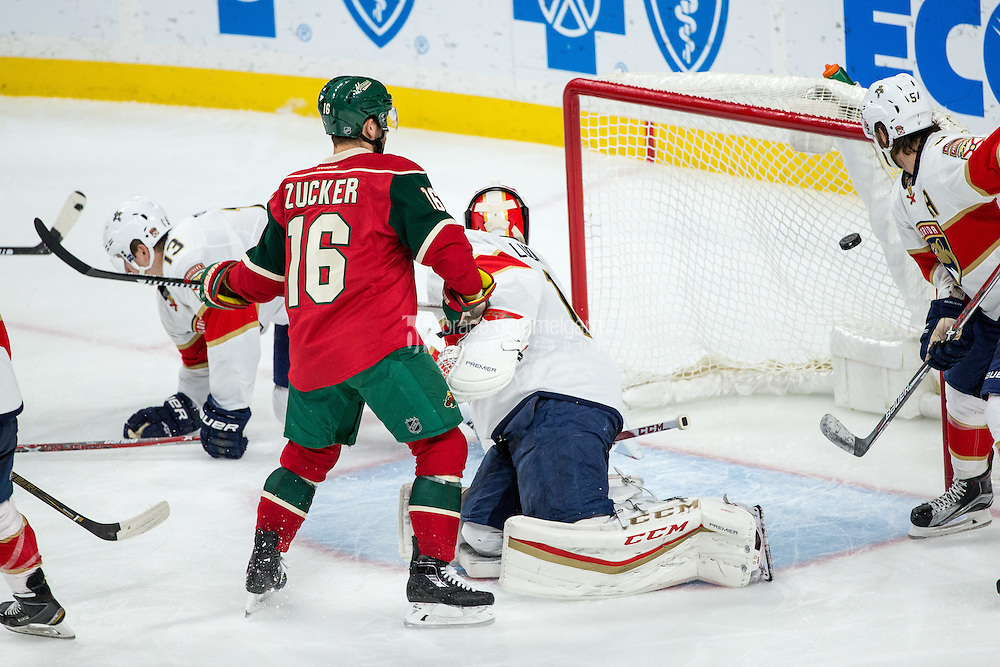 Dec 13, 2016; Saint Paul, MN, USA; Minnesota Wild forward Jason Zucker (16) watches a goal scored by forward Mikko Koivu (not pictured) in front of Florida Panthers goalie Roberto Luongo (1) during the third period at Xcel Energy Center. The Wild defeated the Panthers 5-1. Mandatory Credit: Brace Hemmelgarn-USA TODAY Sports