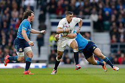 England Inside Centre Luther Burrell is tackled - Photo mandatory by-line: Rogan Thomson/JMP - 07966 386802 - 14/02/2015 - SPORT - RUGBY UNION - London, England - Twickenham Stadium - England v Italy - 2015 RBS Six Nations Championship.