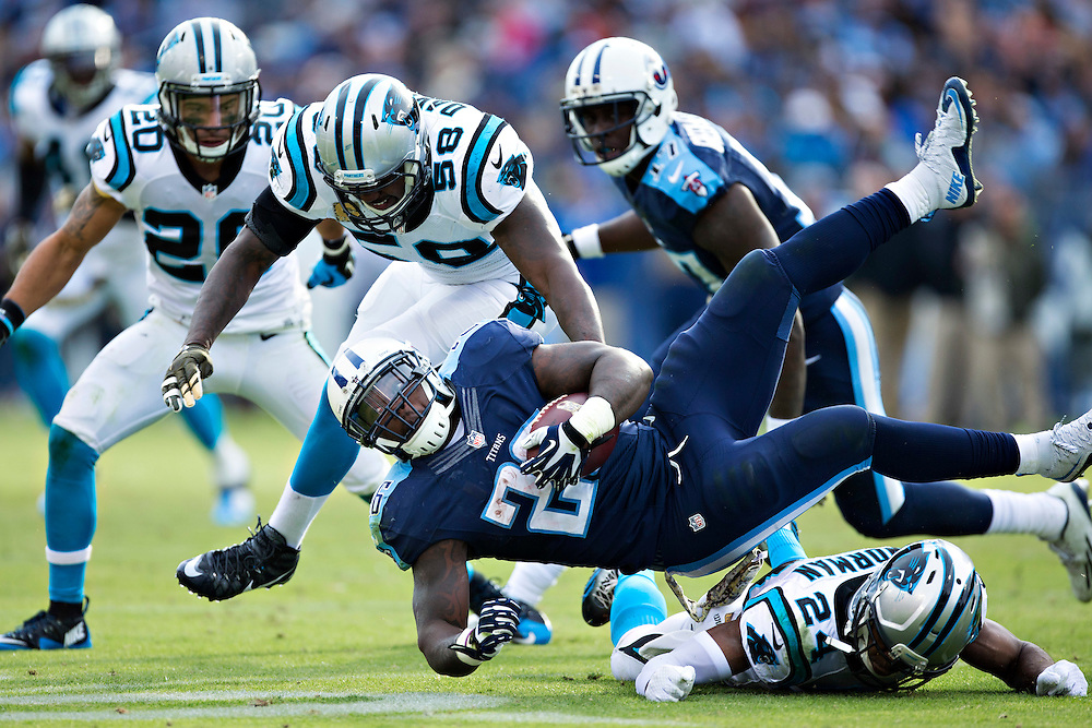 NASHVILLE, TN - NOVEMBER 15:  Antonio Andrews #26 of the Tennessee Titans is tackled by Josh Norman #24 of the Carolina Panthers at Nissan Stadium on November 15, 2015 in Nashville, Tennessee.  (Photo by Wesley Hitt/Getty Images) *** Local Caption *** Antonio Andrews; Josh Norman
