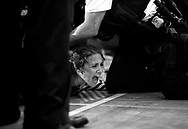 Free Speech in Action: A protestor is tackled by police in the buffer around the rally stage, just below former Secretary Hillary Clinton, while she spoke during a campaign rally in Des Moines, Iowa on Friday August 10, 2016. (photo by Melina Mara/The Washington Post)