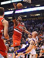 Nov. 21, 2012; Phoenix, AZ, USA; Portland Trail Blazers forward LaMarcus Aldridge (12) charges the Phoenix Suns center Marcin Gortat (4) in the first half at US Airways Center. Mandatory Credit: Jennifer Stewart-US PRESSWIRE.
