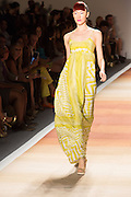 A long yellow and white print dress with  spaghetti straps.