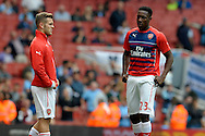 Arsenal's Danny Welbeck (r) talking to Arsenal's Jack Wilshere during pre-match training before k/o.Barclays Premier league match, Arsenal v Manchester city at the Emirates Stadium in London on Saturday 13th Sept 2014.<br /> pic by John Patrick Fletcher, Andrew Orchard sports photography.