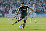 Yoann Barbet (Brentford) plays the ball back to his keeper during the Sky Bet Championship match between Huddersfield Town and Brentford at the John Smiths Stadium, Huddersfield, England on 7 May 2016. Photo by Mark P Doherty.