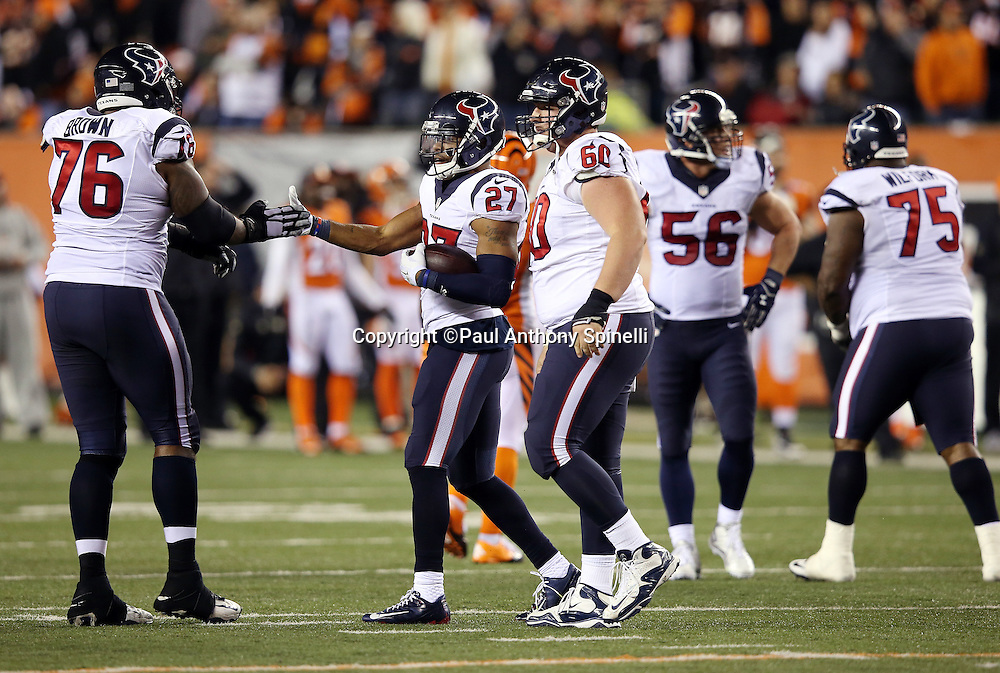 Houston Texans strong safety Quintin Demps (27) gets a congratulatory hand slap from Houston Texans tackle Duane Brown (76) after causing and recovering a late fourth quarter fumble that wins the game for the Texans during the 2015 week 10 regular season NFL football game against the Cincinnati Bengals on Monday, Nov. 16, 2015 in Cincinnati. The Texans won the game 10-6. (©Paul Anthony Spinelli)