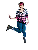Full length of a funky nervous casual young woman jumping in studio on white isolated background