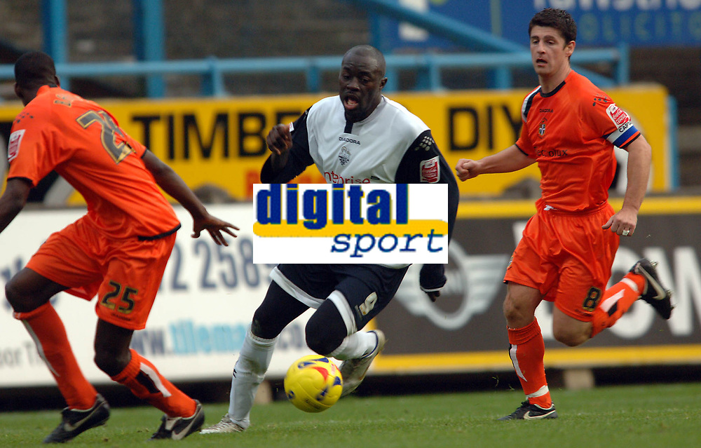 Photo: Paul Greenwood.<br />Preston North End v Luton Town. Coca Cola Championship. 04/11/2006. Prestons tricky player Patrick Agyemang threads the ball between two Luton defenders.