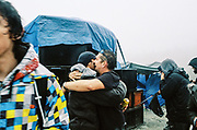 Ravers hugging at MUDTEK, Llanddewi Brefi, Wales 2016