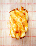 one curled up potato chips slice
