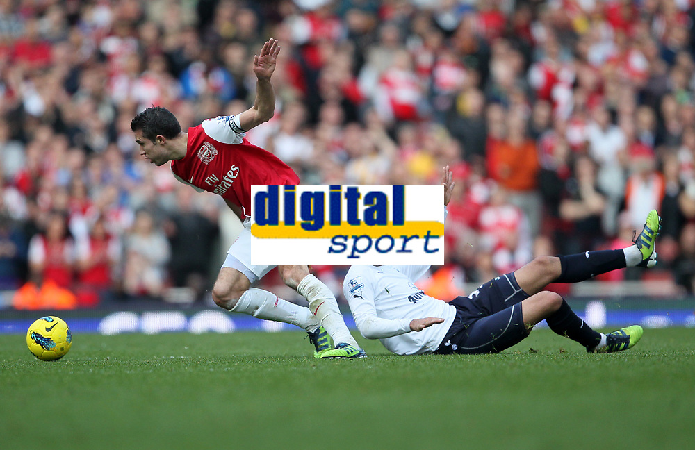 20120226: LONDON, UK - Barclays Premier League 2011/2012: Arsenal vs Tottenham.<br /> In photo: Arsenals Robin Van Persie tussles with Tottenhams Sandro.<br /> PHOTO: CITYFILES