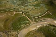 Nederland, Noord-Holland, Texel, 14-07-2008; De Slufter, natuurgebied ontstaan doordat de duinen in het verleden doorgebroken zijn, het gebied staat daardoor in open verbinding met de Noordzee; Sluftervallei, Staatsbosbeheer, nationaal park, vloed, geul, eb, duindoorbraak, kreek, kreken, krekenstelsel, kwelder,  vogelreservaat, natuurreservaat, Slufter valei, zeegat, gat, zand, wad, wadden. .luchtfoto (toeslag); aerial photo (additional fee required); .foto Siebe Swart / photo Siebe Swart