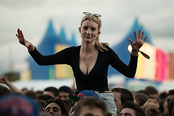 © Licensed to London News Pictures . 07/06/2014 . Heaton Park , Manchester , UK . A woman dances in the crowd during the show . Snoop Dogg performs on the Main Stage at the Parklife music festival in Heaton Park Manchester . Photo credit : Joel Goodman/LNP