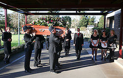 **NOTE: People in police uniform are not real policemen** © Licensed to London News Pictures. 09/12/2015. London, UK. The coffin being carried in to the crematorium by men dressed as policemen, past women dressed as in maids uniforms.... The funeral of former brothel keeper Cynthia Payne takes place at the South London Crematorium.  In 1980 Cynthia Payne was sentenced to 18 months for running a brothel at her house on Ambleside Avenue in Streatham. It was alleged, at the time, that judges and Members of Parliament were visitors to her establishment. Photo credit: Peter Macdiarmid/LNP