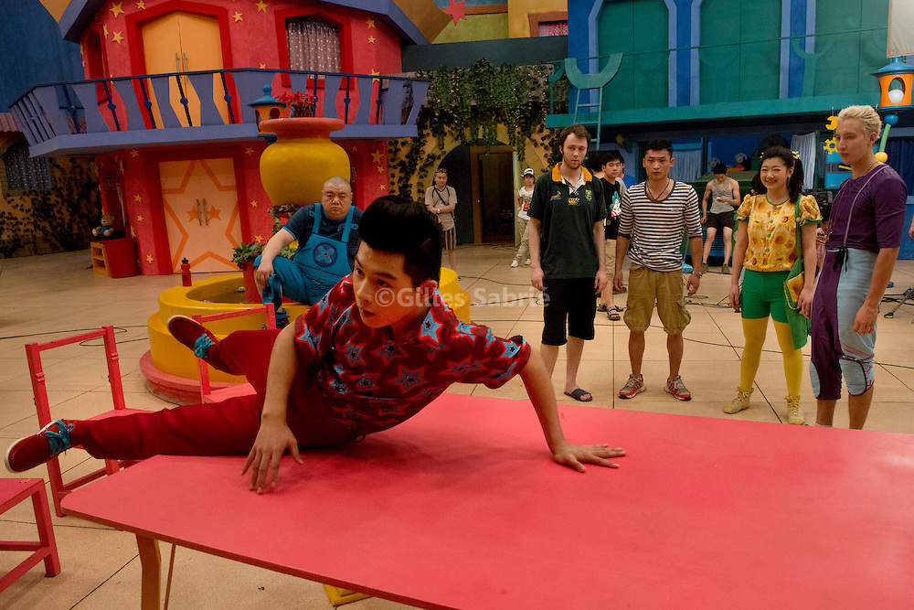 For a story by Scott Murdoch<br /> Beijing, August 14th 2013<br /> On the production set of the children's programme &quot;Hoopla Doopla!&quot;, Zhang Haoran (right) performs a stunt, wile other actors look on.<br /> Gilles Sabrie for the Australian