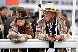 Horse racing pundit John McCririck (right) with wife Jenny during Gold Cup Day at Cheltenham Racecourse