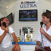 March 11, 2014. Indian Wells, California. Alexandr Dolgopolov chats in the Michelob ULTRA booth during the 2014 BNP Paribas Open. (Photo by Billie Weiss/BNP Paribas Open)
