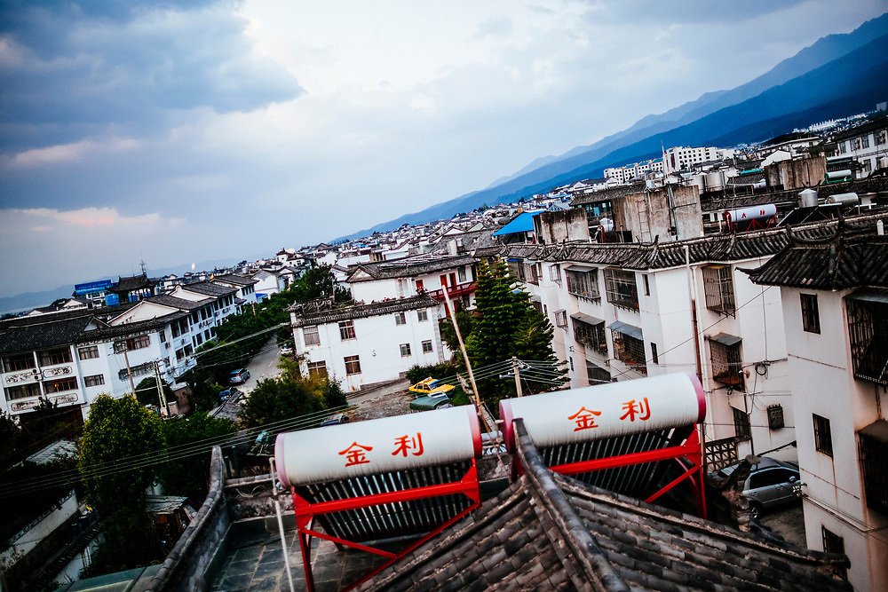 A view from the rooftop of Ye Yongqing's home in Dali, China, with surrounding homes and the Cangshan Mountains in the background. Mr. Ye's home is in the center of downtown Dali.