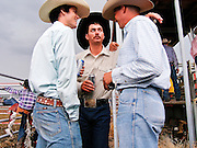 "30 JULY 2005 - WILLIAMS, ARIZONA, USA: Cowboys behind the chutes wait to compete at the Arizona Cowpunchers' Reunion Rodeo, the largest amateur rodeo in Arizona, in Williams, AZ, July 30. Professional rodeo cowboys cannot participate in the rodeo. Only working ranch cowboys and their families can participate in the rodeo, which features sports more geared to ranch life, like ""wild cow milking"" than pro rodeos, which feature bull riding. Williams, a small ranching town in northern Arizona and about an hour from the south entrance to the Grand Canyon National Park, has reinvented itself as a tourist destination. The town draws tourists going to the park and tourists who want to experience American western lifestyle. The town hosts the largest amateur rodeo in Arizona drawing contestants and spectators from across the state. PHOTO BY JACK KURTZ"