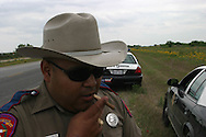 Texas police patrol the border between Texas and Mexico.
