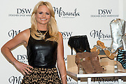 Miranda Lambert poses for a photo at the DSW Designer Shoe Warehouse in Frisco, Texas on April 24, 2014. (Cooper Neill)