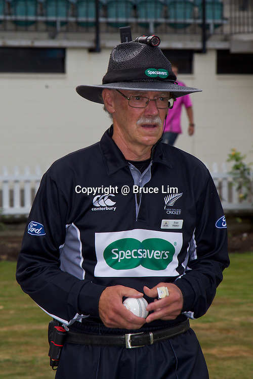 Umpire Evan Watkin with the new umpire camera shortly before the HRV Cup Twenty20 Cricket match, Northern Knights v Canterbury Wizards, 11 January 2013.  Photo: Bruce Lim / Photosport.co.nz
