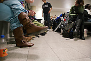 passengers waiting at the boarding terminal at JFK airport