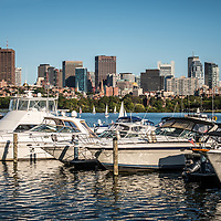 Boston Skyline with boats along the Charles River. Boston Massachusetts is a major city in the Eastern United States of America.