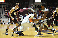 "Mississippi Rebels guard Terence Smith (3) is surrounded by Texas A&M Aggies guard Jalen Jones (12) and Texas A&M Aggies forward Tavario Miller (4) at the C.M. ""Tad"" Smith Coliseum in Oxford, Miss. on Wednesday, February 4, 2015. (AP Photo/Oxford Eagle, Bruce Newman)"