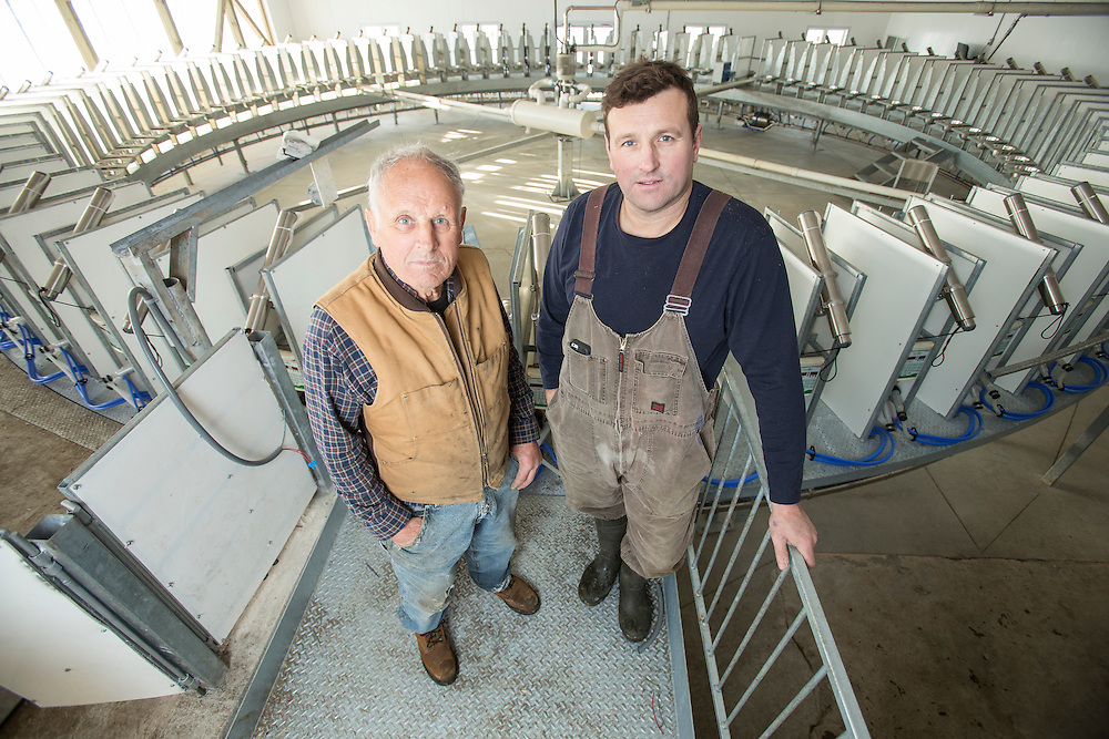 Dairy goat farmers Leo Donkers, left, and his son Ed stand near their new rotary milking parlour on their farm near Shedden, Ontario, Monday,  February 2, 2015.<br /> Farmers Forum/ Geoff Robins
