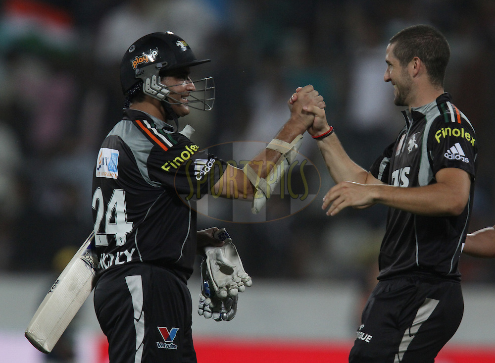 Sourav Ganguly of Pune Warriors being congratulated by teammate Wayne Parnell after winning  during match 53 of the Indian Premier League ( IPL ) between the Deccan Chargers and the Pune Warriors India held at the Rajiv Gandhi International Cricket Stadium in Hyderabad on the 10th May 2011..Photo by Parth Sanyal/BCCI/SPORTZPICS