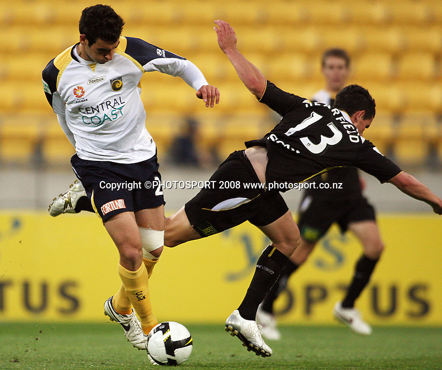 Troy Hearfield is brushed aside by Sasho Petrovski.<br /> A-League - Wellington Phoenix v Central Coast Mariners at Westpac Stadium, Wellington. Friday, 19 December 2008. Photo: Dave Lintott/PHOTOSPORT