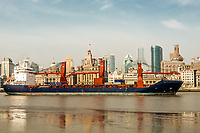 Shanghai, China - April 7, 2013: cargo ship on the bund waterfront Hangpu river at the city of Shanghai in China on april 7th, 2013