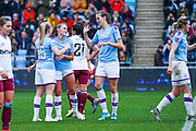 Manchester City Women forward Lauren Hemp (15) scores a goal and celebrates with Manchester City Women midfielder Jill Scott (8) and Manchester City Women forward Georgia Stanway (10) to make the score 4-0 during the FA Women's Super League match between Manchester City Women and West Ham United Women at the Sport City Academy Stadium, Manchester, United Kingdom on 17 November 2019.