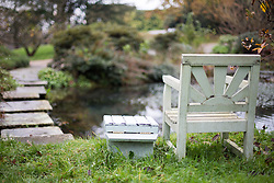 "@Licensed to London News Pictures 23/01/2015. Chartwell House, Westerham, Kent (21/11/14). The goldfish pond and chair at Chartwell in Kent. The exhibition ""Death of a Hero"" marks the 50th anniversary of the passing of statesman and wartime leader, Sir Winston Churchill, who lived at Chartwell, Westerham  Photo credit: Manu Palomeque/LNP"