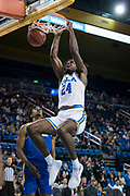 UCLA Bruins forward Jalen Hill (24) dunks against the San Jose State Spartans during an NCAA college basketball game, Sunday, Dec. 1, 2019, in Los Angeles. UCLA defeated San Jose State 93-64. (Jon Endow/Image of Sport)