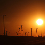 Power generating wind farms at sunset near Dwight, in central Illinois<br />