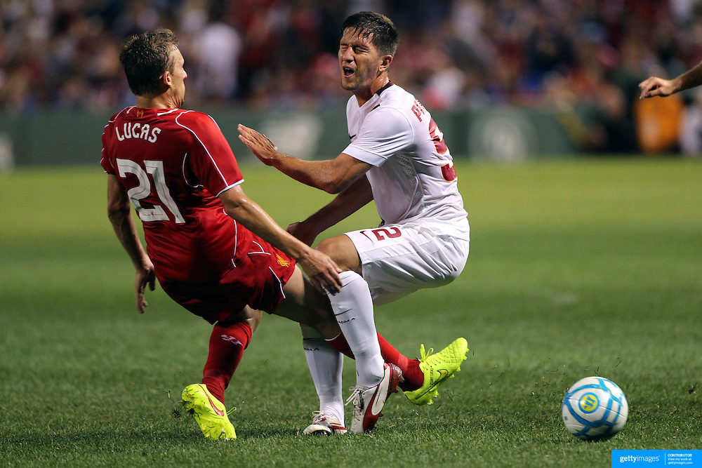 Stefano Pettinari , (right), AS Roma, is fouled by Lucas Leiva, Liverpool, in action during the Liverpool Vs AS Roma friendly pre season football match at Fenway Park, Boston. USA. 23rd July 2014. Photo Tim Clayton