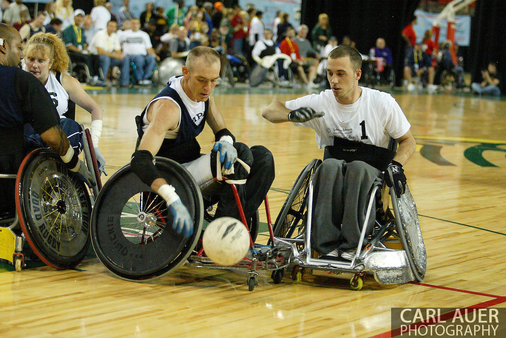 July 7th, 2006: Anchorage, AK - David Nau (7) puts the ball on the floor as Thomas Durbin (1) plays tight defense as White defeated Blue in the gold medal game of Quad Rugby at the 26th National Veterans Wheelchair Games.