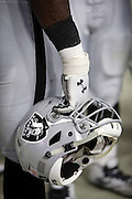An Oakland Raiders player holds his helmet at his side on the sideline during the 2016 NFL preseason football game against the Arizona Cardinals on Friday, Aug. 12, 2016 in Glendale, Ariz. The Raiders won the game 31-10. (©Paul Anthony Spinelli)