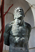 San Sebastiano, bronze sculpture, 2011, detail, by Ettore Greco, in a niche at the Mausoleum at Vittoriale degli italiani, or The Shrine of Italian Victories, the home, estate and museums of Gabriele D'Annunzio, 1863-1938, Italian writer, soldier and fascist, at Gardone Riviera, Lake Garda, Brescia, Lombardy, Italy. The estate consists of the Prioria, where d'Annunzio lived 1922-38, an amphitheatre, the protected cruiser Puglia, the MAS vessel used by D'Annunzio in 1918 and a mausoleum. It is part of the Grandi Giardini Italiani. Picture by Manuel Cohen