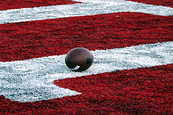 Football lying in the endzone.