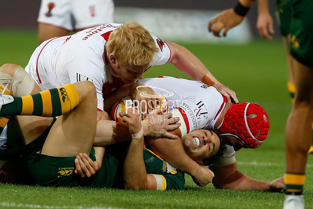 Billy Slater of Australia gets tackled by Chris Hill of England  during the Rugby League World Cup match between Australia and England at Melbourne Rectangular Stadium, Melbourne, Australia on 27 October 2017. Photo by Mark  Witte.