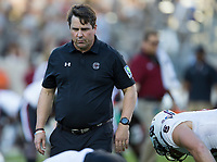 South Carolina head coach Will Muschamp looks over his team before the start of an NCAA college football game against Texas A&M Saturday, Sept. 30, 2017, in College Station, Texas. (AP Photo/Sam Craft)