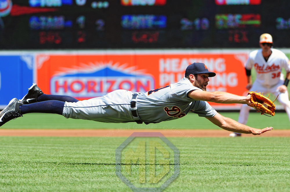 02 August 2015:  Detroit Tigers starting pitcher Daniel Norris (44) makes a diving catch on a bunt attempt by the Baltimore Orioles at Orioles Park at Camden Yards in Baltimore, MD. (Photograph by Mark Goldman - Goldminephotos)