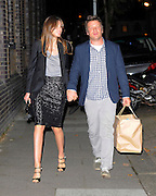 03.OCTOBER.2012. LONDON<br /> <br /> JAMIE AND JOOLS OLIVER LEAVING GWYNETH PALTROW'S 40TH BIRTHDAY PARTY AT THE RIVER CAFE, THAMES WALK IN LONDON.<br /> <br /> BYLINE: EDBIMAGEARCHIVE.CO.UK<br /> <br /> *THIS IMAGE IS STRICTLY FOR UK NEWSPAPERS AND MAGAZINES ONLY*<br /> *FOR WORLD WIDE SALES AND WEB USE PLEASE CONTACT EDBIMAGEARCHIVE - 0208 954 5968*