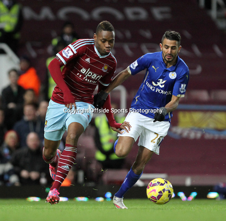 20 December 2014. Premiership. West Ham v Leicester.<br /> Diafra Sakho of West Ham and Riyad Mahrez of Leicester fight for the ball.<br /> Photo: Charlotte Wilson