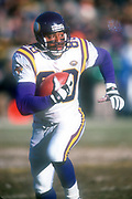 Minnesota Vikings receiver Cris  Carter (80) carries the ball against the Green Bay Packers during an NFL football game, Sunday, Dec. 30, 2001, in Green Bay, Wisc. The Packers defeated the Vikings 24-13.